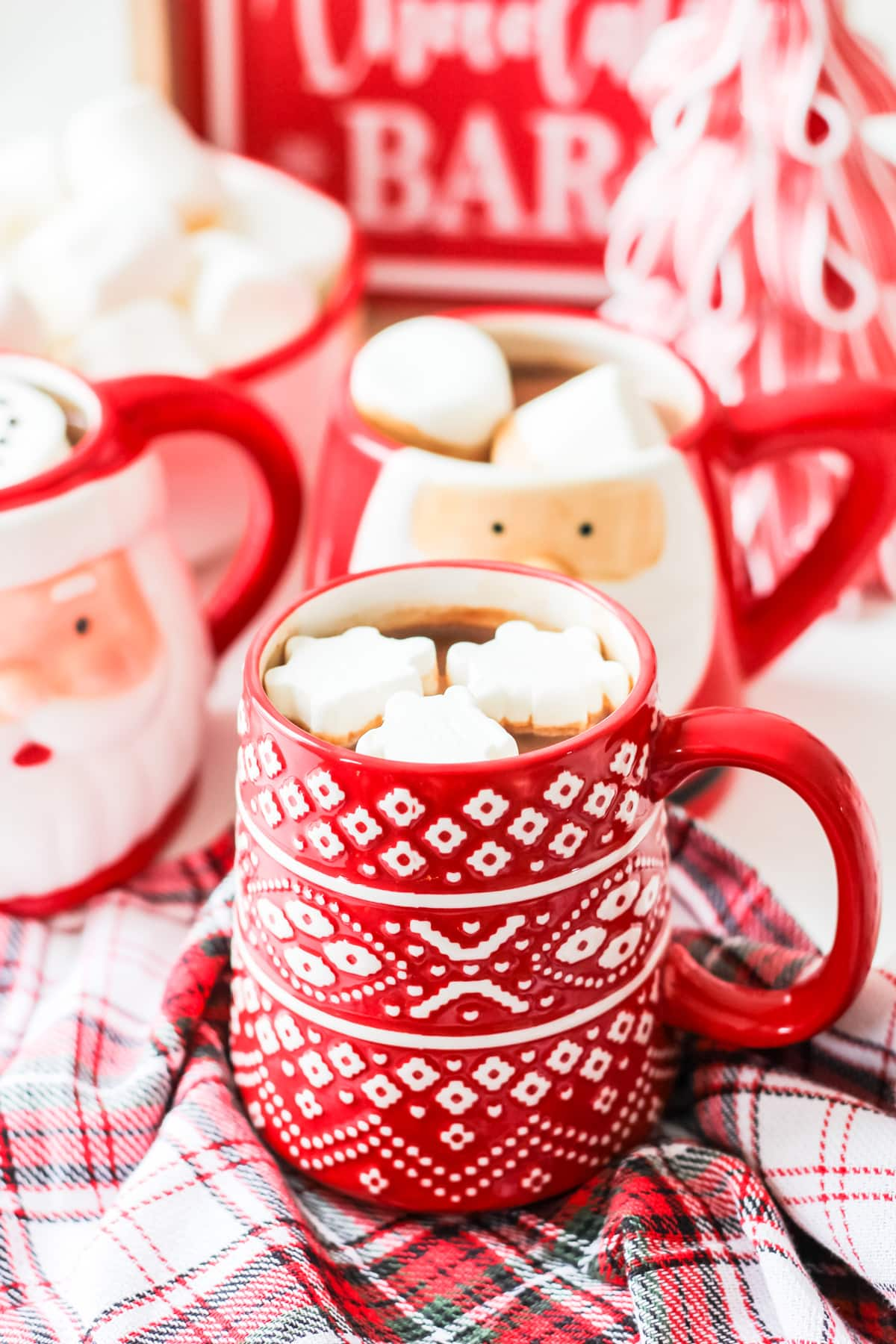 A red and white mug of hot chocolate and marshmallows