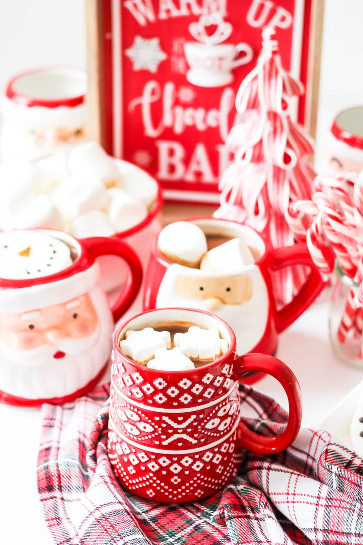 Santa mugs full of hot chocolate and marshmallows