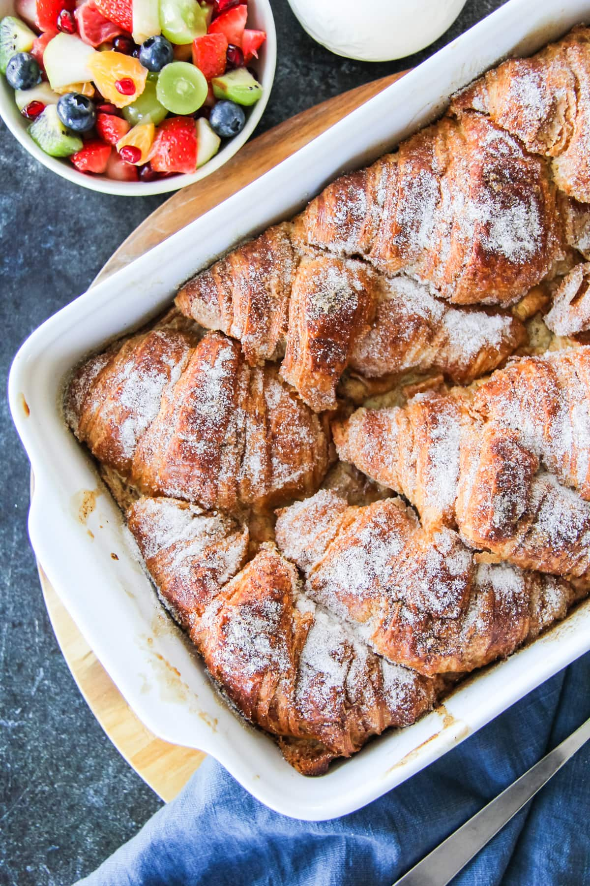 a top down view of a Croissant French Toast Bake and fruit salad