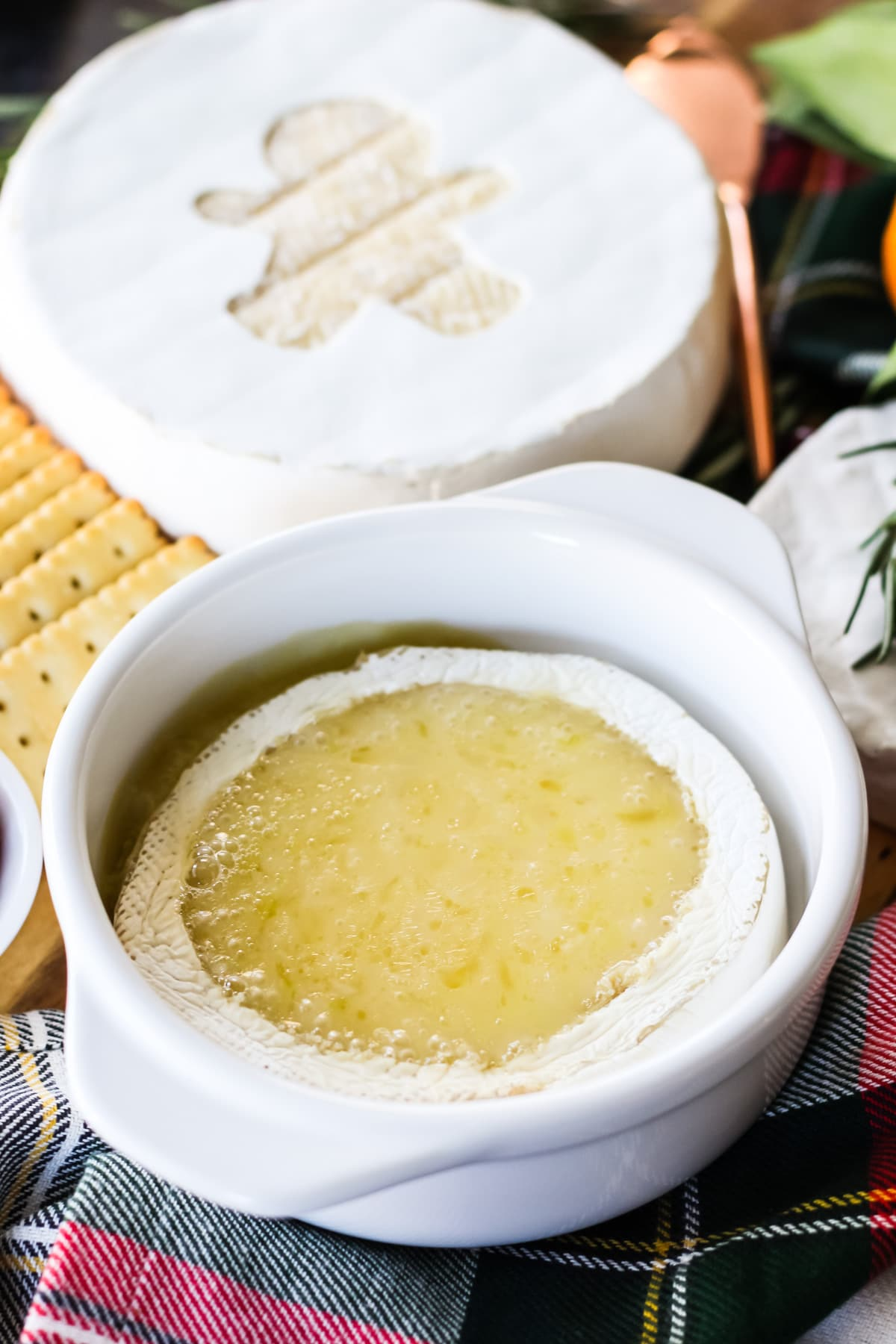 a baked Brie cheese wheel with the rind removed and turned into a fondue