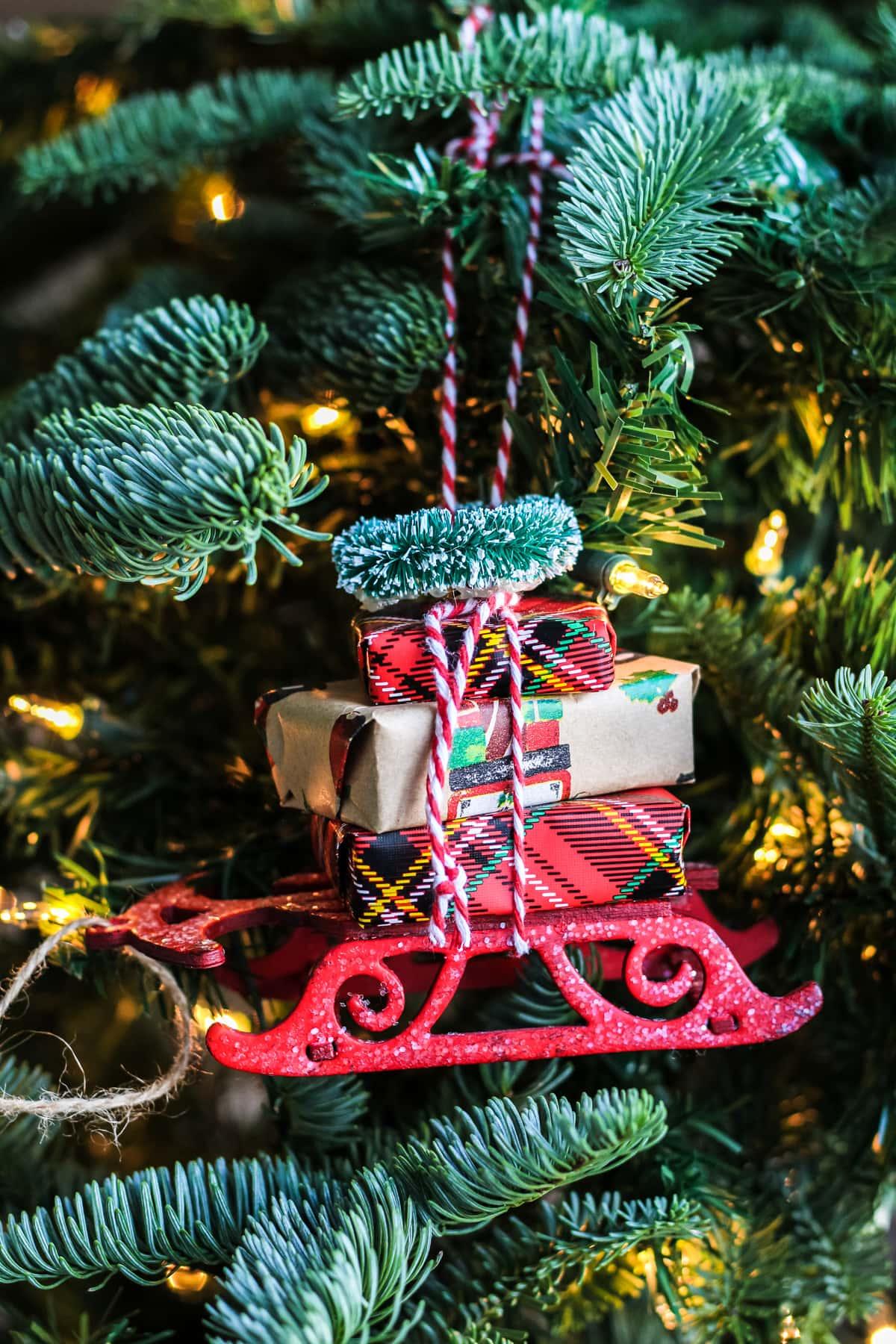A Christmas Sleigh Ornament hanging on a Christmas tree