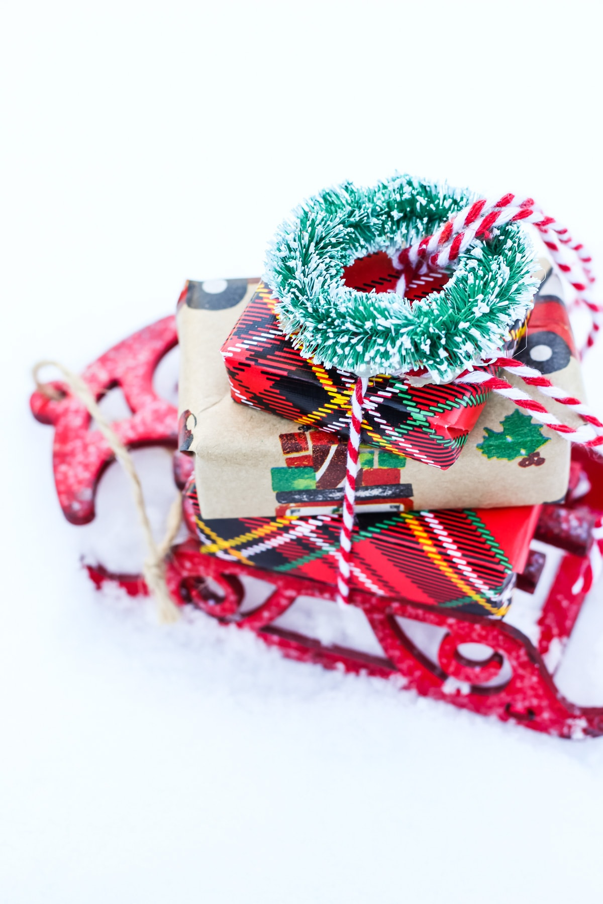 A Christmas Sleigh Ornament in the snow