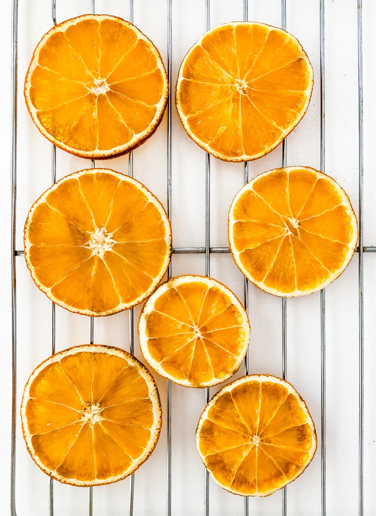 A cooling rack with dried orange slices