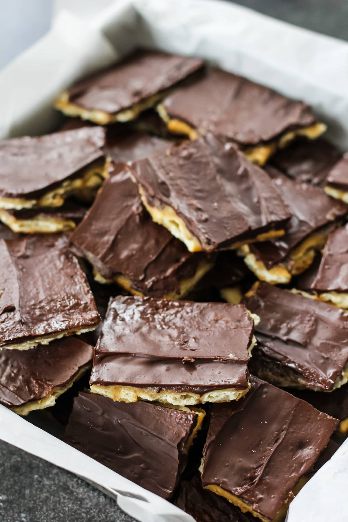 a top down view of squares of chocolate covered squares of Christmas Crack