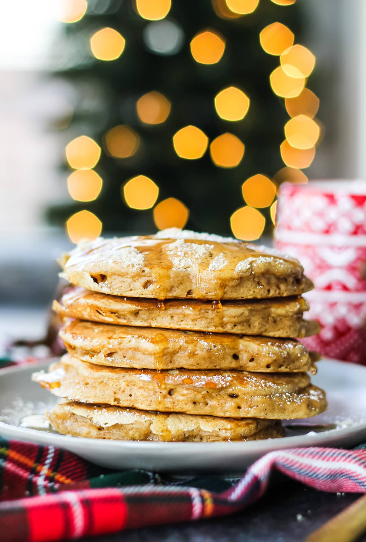 a stack of Gingerbread Pancakes against a background of Bokeh light