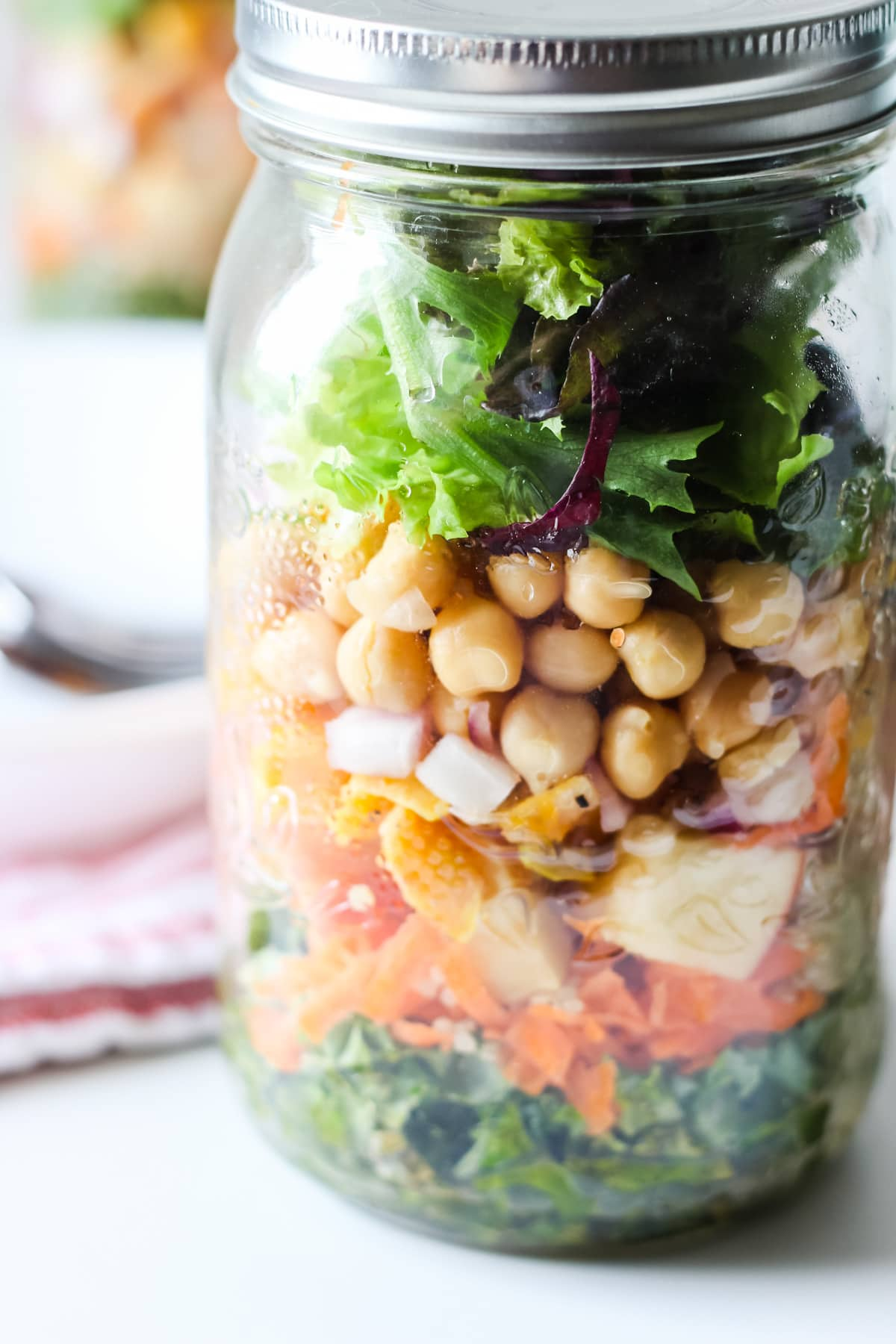 a close up of a Mason Jar Salad