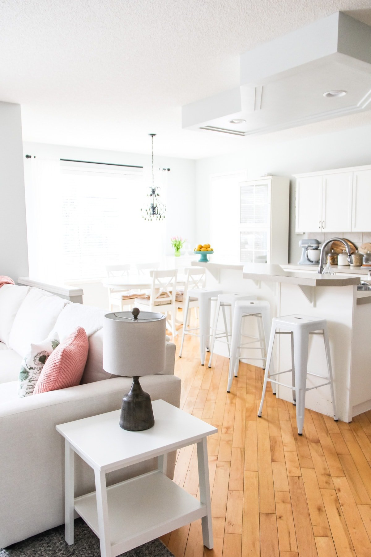 a view of a bright white kitchen space