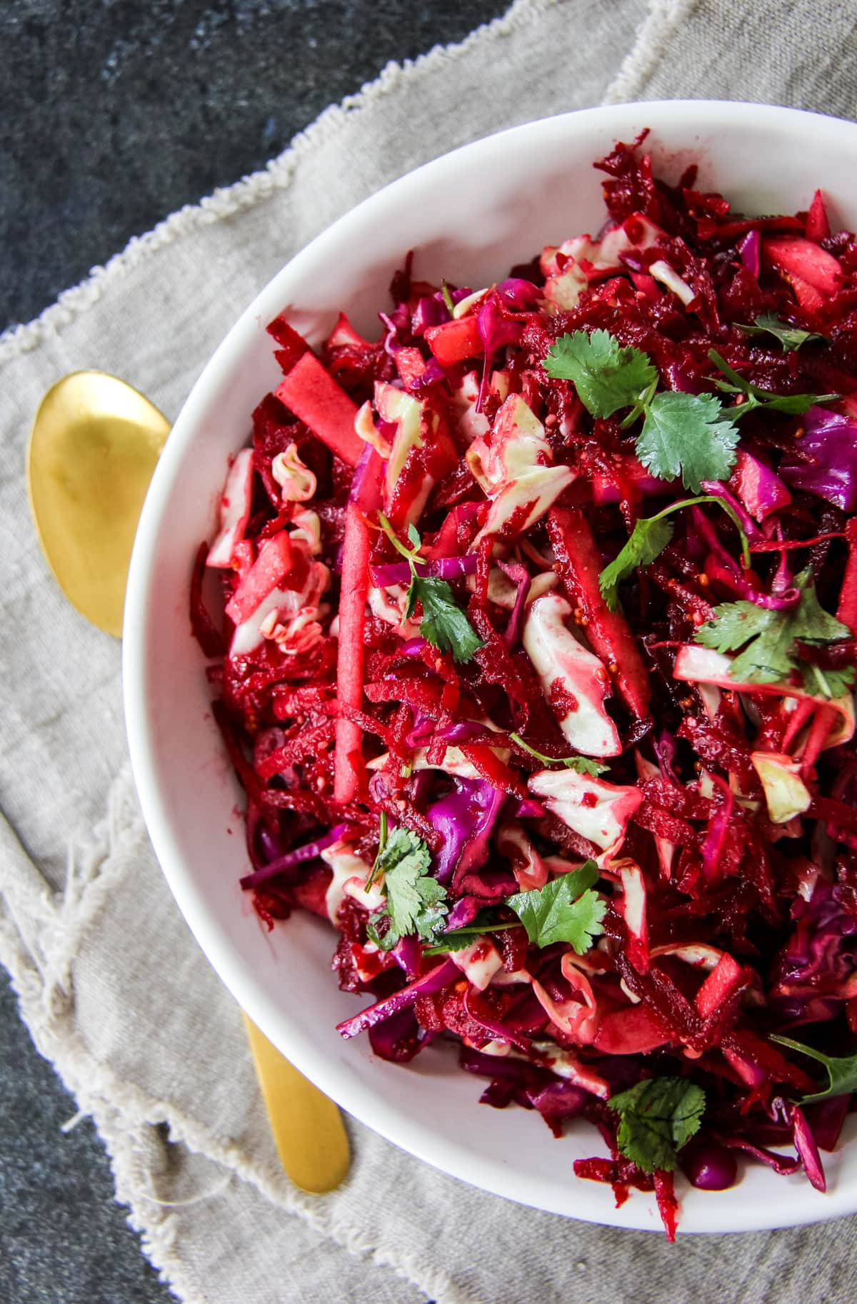 a top down view of half of a bowl of Apple Beet Slaw