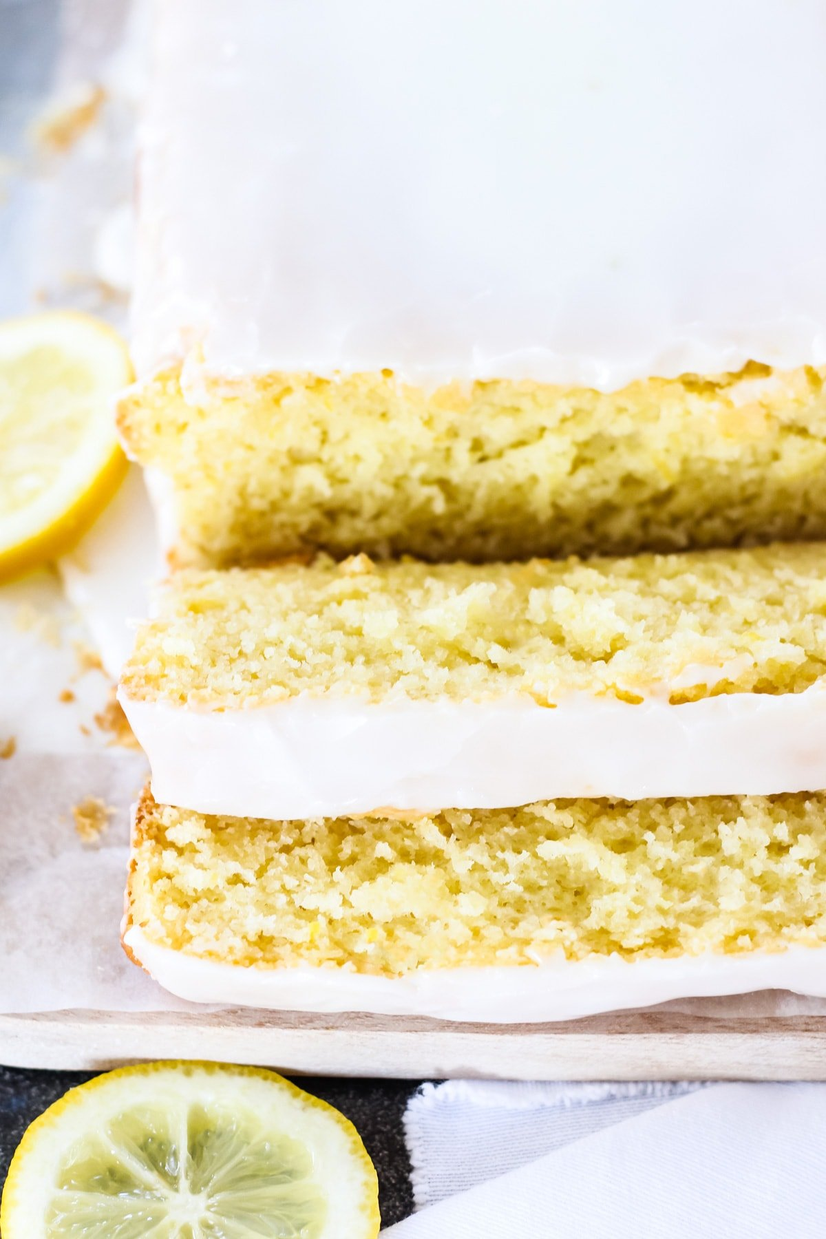 a front view of half of a lemon loaf topped with white icing