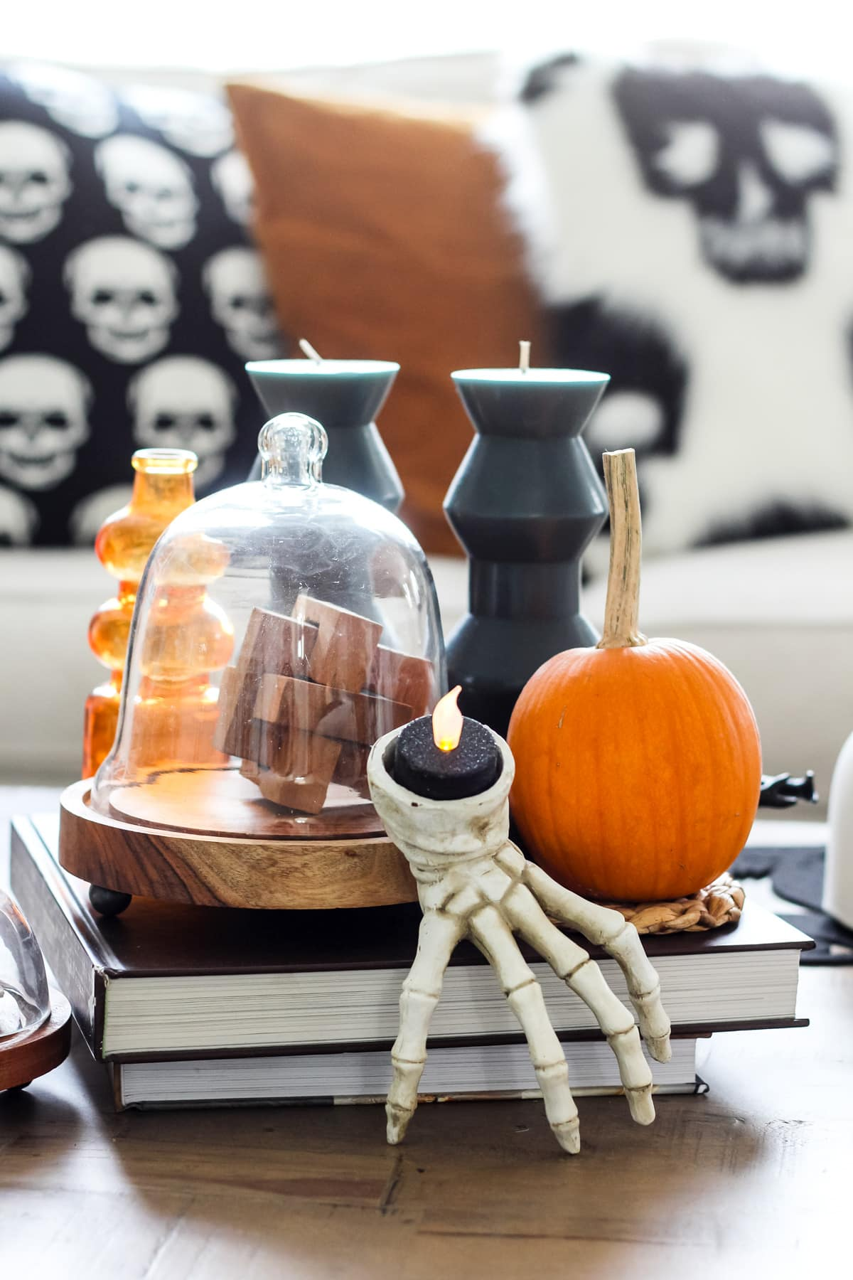 a wooden coffee table filled with Halloween decorations